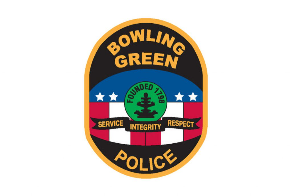 "Bowling Green Police Department badge. Stars above vertical stripes in the middle. A circle in the center reads ""founded 1798"" and below the circle a banner reads ""service integrity respect"""