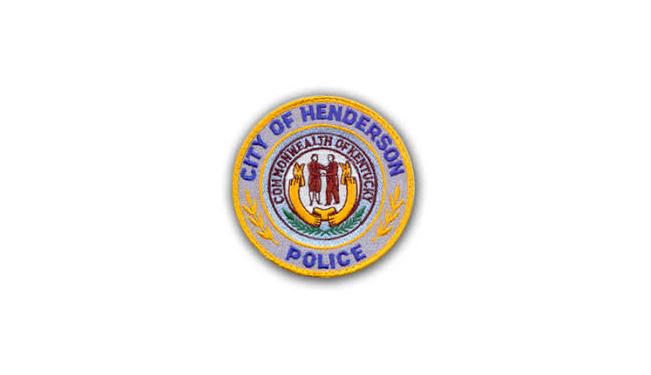City of Henderson Police circular seal. At center is two men shaking hands - as is on the Kentucky state flag - and Commonwealth of Kentucky arches above and an empty banner is below their feet.