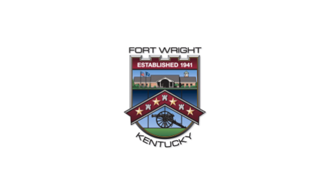 """City of Fort Wright shield. """"Fort Wright"""" above the shield, """"Established 1941"""" is across the top of the shield. Below that is a rendering of the ciy building. A chevron is across the middle pointing up with stars and fort battlement icons alternating across it. A cannon is at the bottom of the shield, and """"Kentucky"""" curves below the bottom of the shield."""