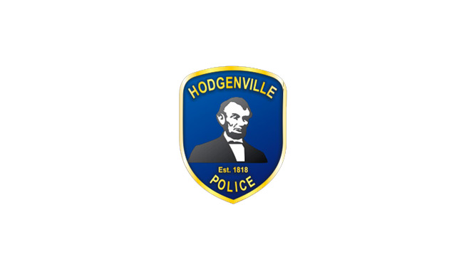 """Hodgenville police shield logo. The top of the shield reads """"Hodgenville"""" and the bottom reads """"Police."""" At the center of the shield is Abraham Lincoln in relief, and below his bust reads """"Est. 1818"""""""